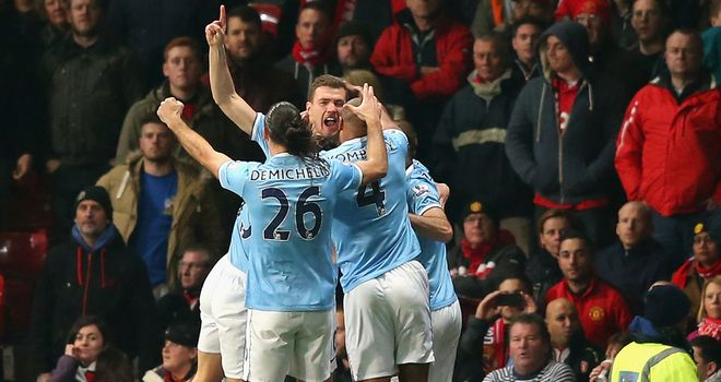 Edin Dzeko: Celebrates early opener for City
