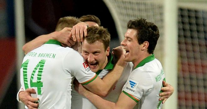 Philipp Bargfrede of Bremen celebrates