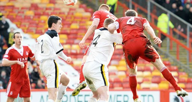 Adam Rooney: Aberdeen striker scores against Dumbarton at Pittodrie