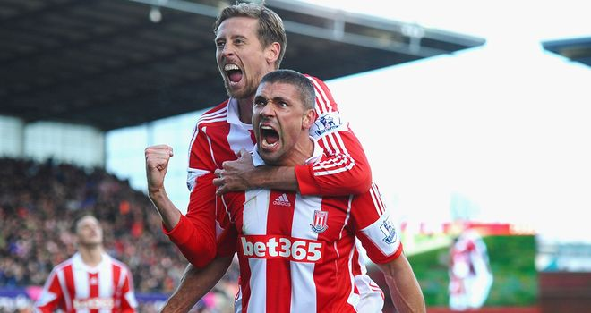 Jon Walters and Peter Crouch celebrate the winning goal