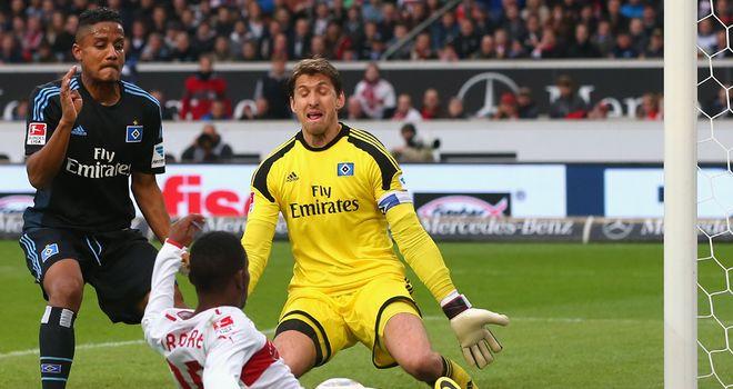 Ibrahima Traore battles for the ball with Rene Adler