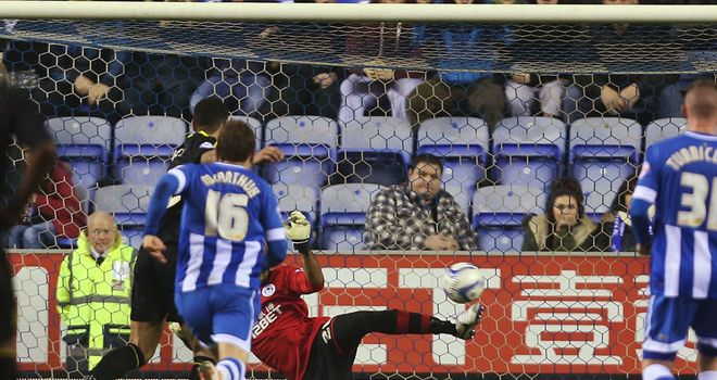 Ali Al-Habsi: Saves the penalty from Sheffield Wednesday's Leon Best