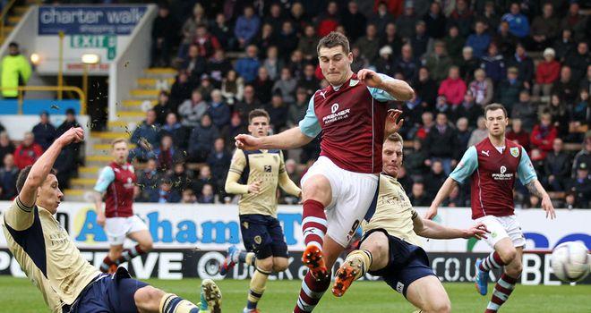 Jason Pearce (l): Leeds defender scores an own goal at Burnley