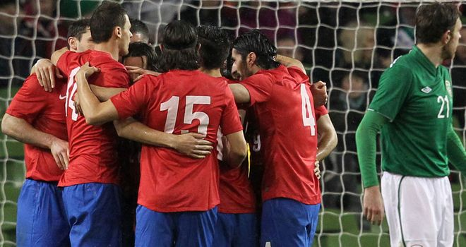 Serbia: Celebrate their equaliser against Republic of Ireland