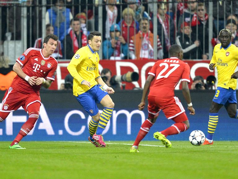 Mesut Ozil: In action during 1-1 draw at Bayern Munich