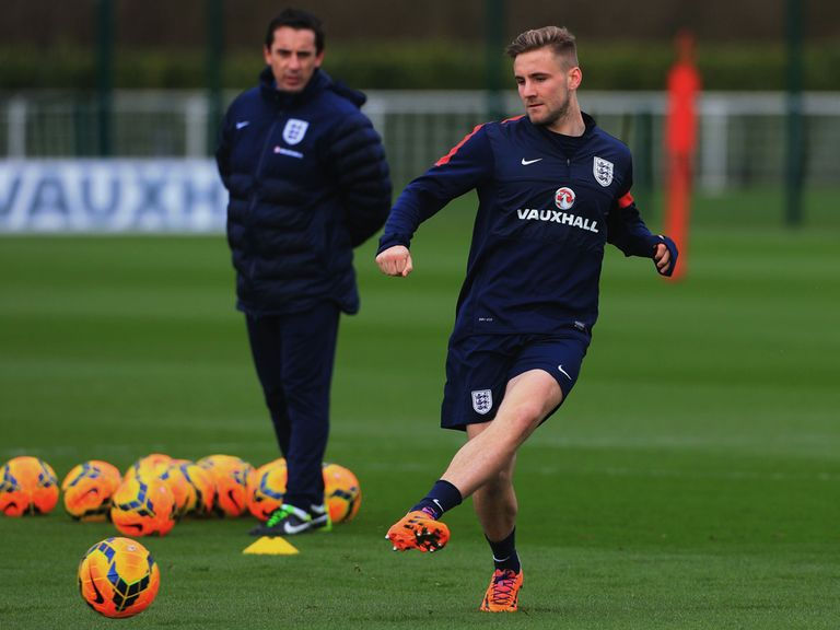 Gary Neville watches Luke Shaw train