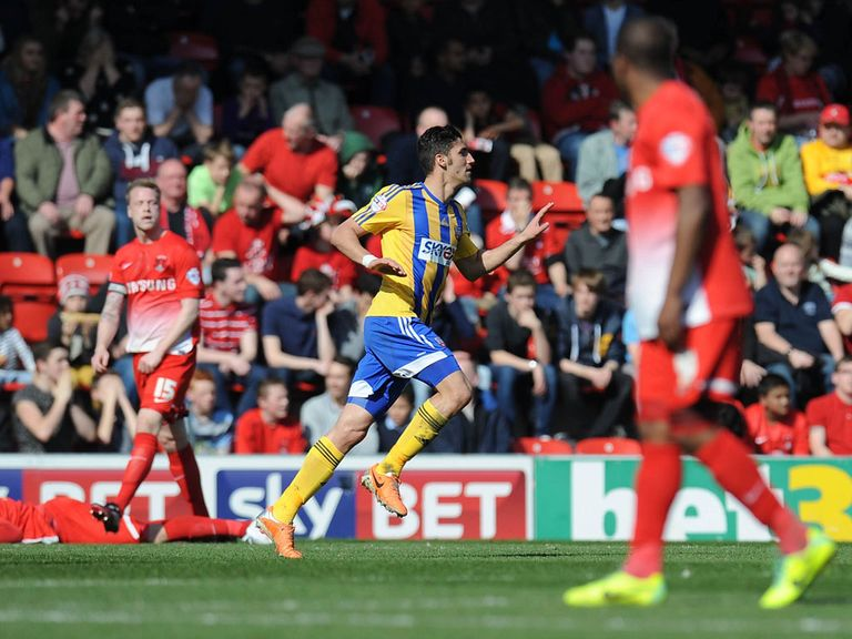 Marcello Trotta celebrats scoring for Brentford