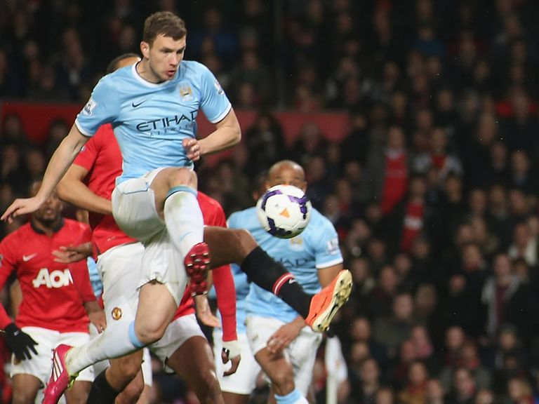 Edin Dzeko of Manchester City scores their second goal during the Manchester derby