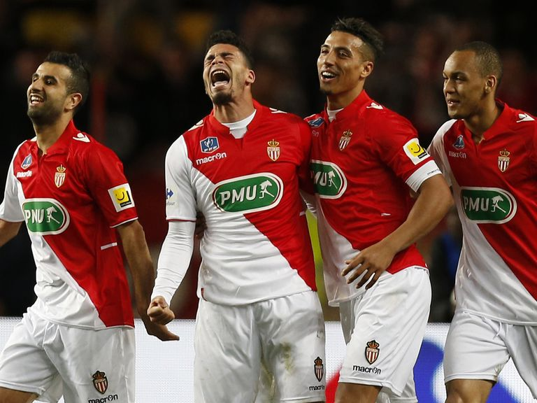 Monaco's French forward Emmanuel Riviere (2nd left) celebratesfootba
