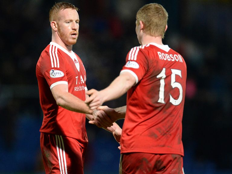 Aberdeen's Adam Rooney (left) shakes hands with team-mate Barry Robson