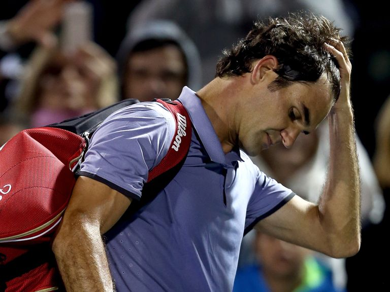 Roger Federer leaves court after losing to Kei Nishikori