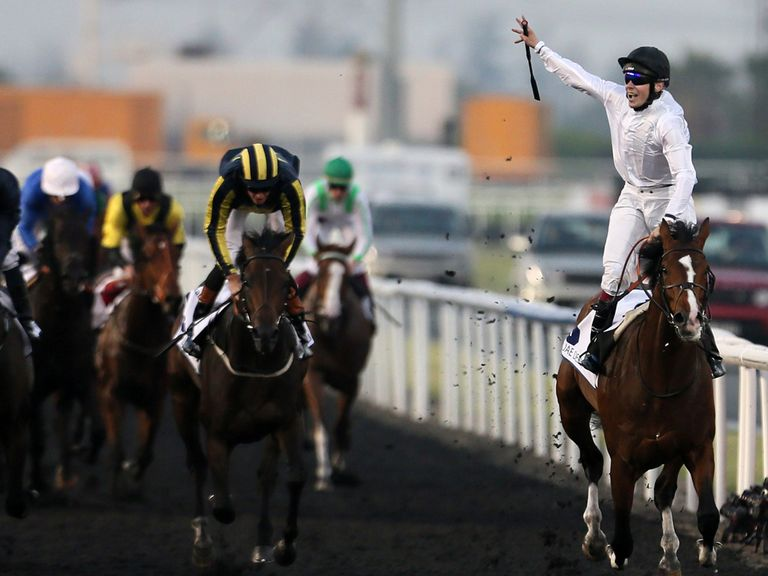 Jamie Spencer celebrates on Toast of New York after winning the UAE Derby.