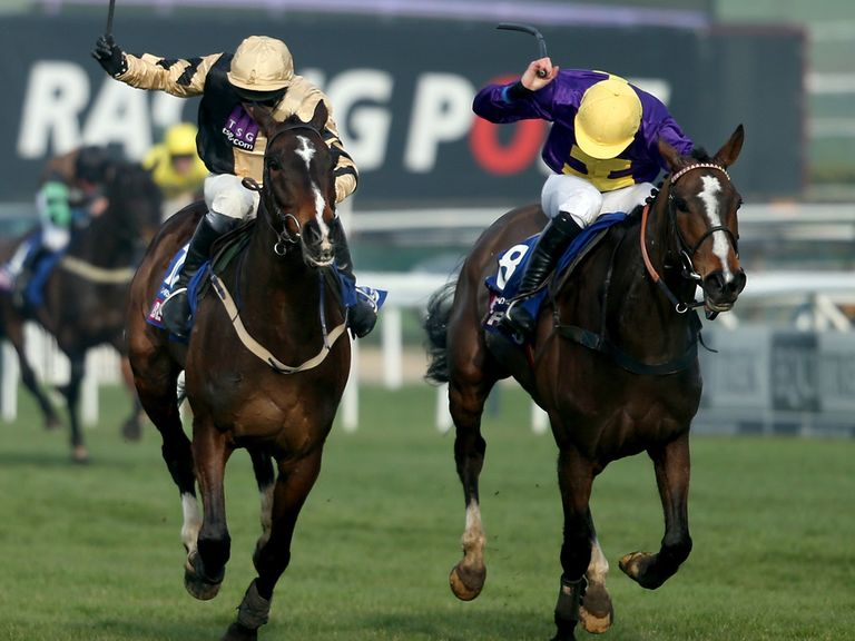 On His Own (left) goes down all guns blazing at Cheltenham