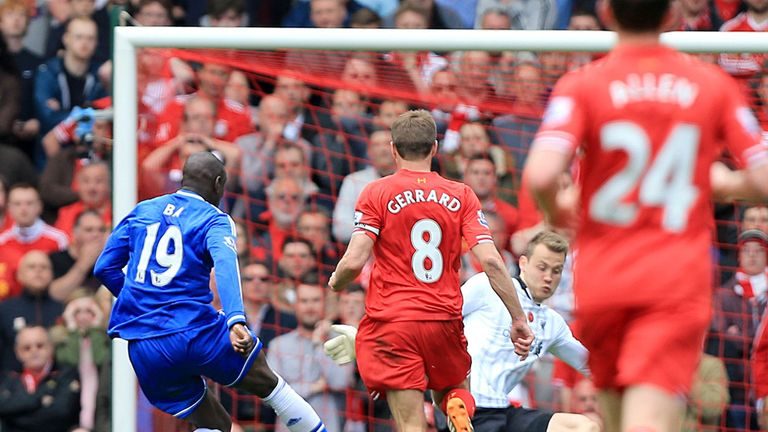 Steven Gerrard looks on as Chelsea's Demba Ba punishes his error