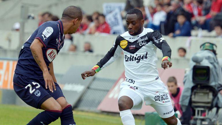 Ferreira Mariano vies for the ball with Ladislas Douniama