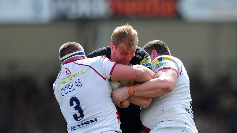 Vadim Cobilas and Eifion Lewis Roberts wrap up Exeter's Damian Welch