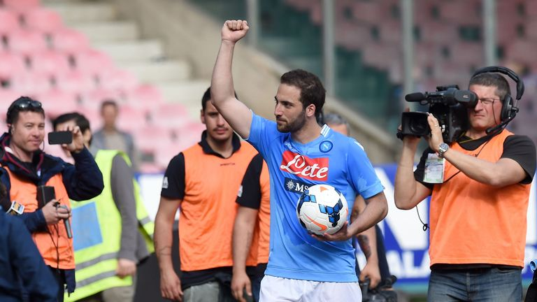 Gonzalo Higuain: Napoli striker celebrates with the match ball