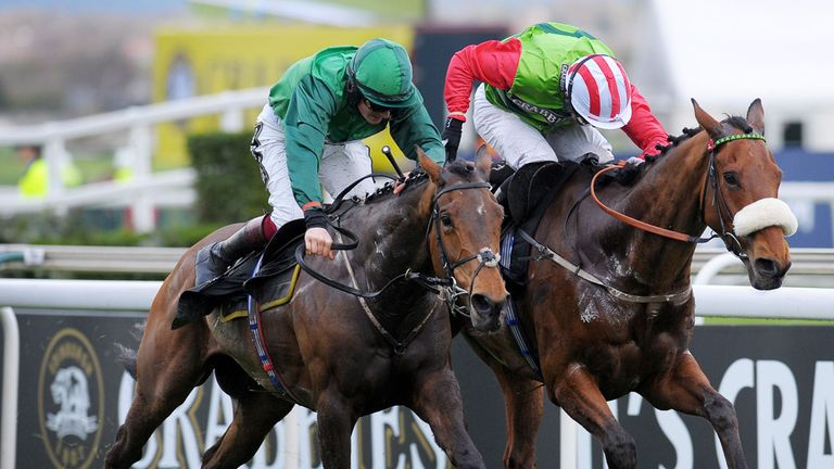 Relic Rock (right) is narrowly edged out at Aintree