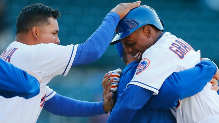 Curtis Granderson: Mobbed by teammates after turning jeers to cheers as New York Mets edged Atlanta Braves