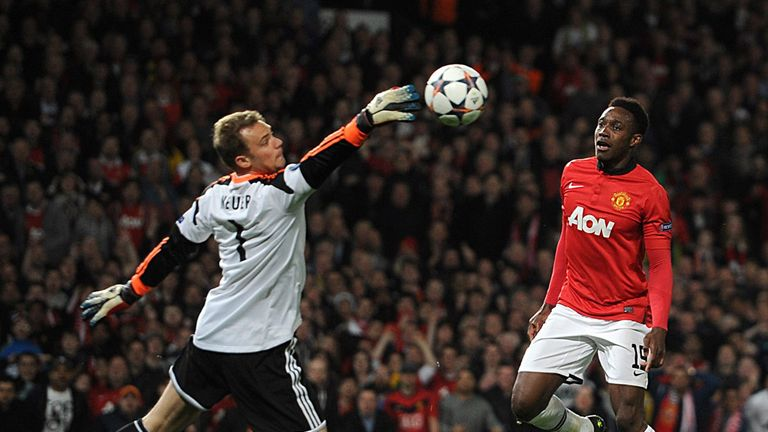 Bayern Munich's goalkeeper Manuel Neuer (left) saves Manchester United's Danny Welbeck (centre) shot