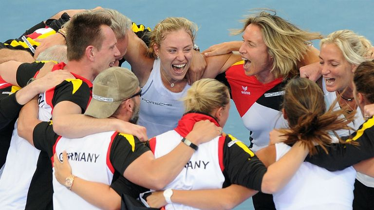 Angelique Kerber and the Germany team celebrate after beating Australia