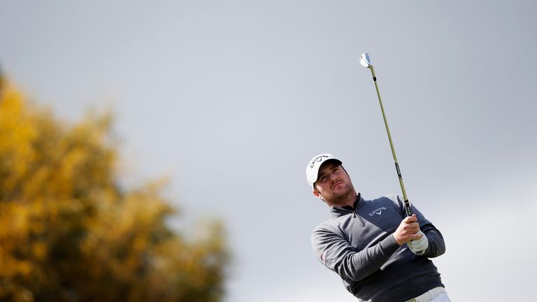Marc Warren of Scotland hits his tee shot on the 8th hole