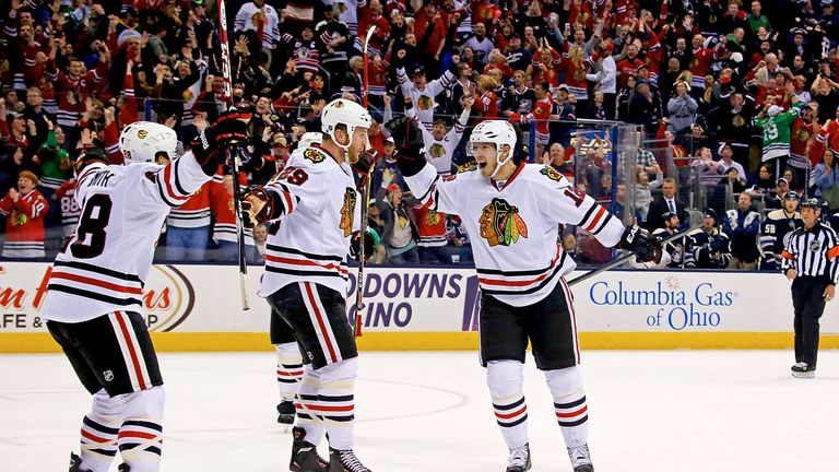 Ben Smith celebrates his game winner with his Chicago Blackhawks team-mates