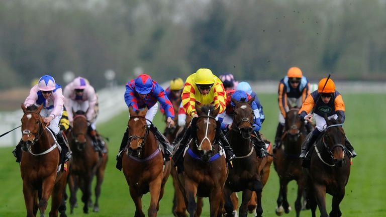 Bobs World (yellow silks) powers clear to win the handicap