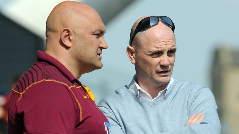 Paul Anderson (L) and Richard Agar look on before Huddersfield's victory