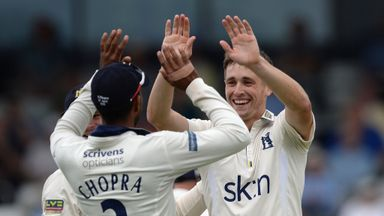 High five: Chris Woakes' bowling put Warwickshire on top in Manchester