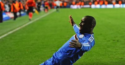 Demba Ba slides towards the Chelsea fans after sending them into the Champions League semi-finals