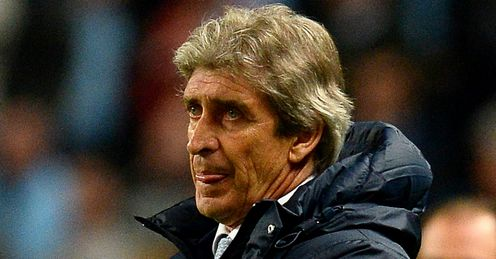 Manuel Pellegrini: Believes Manchester City's heads were elsewhere as they drew 2-2 with Sunderland