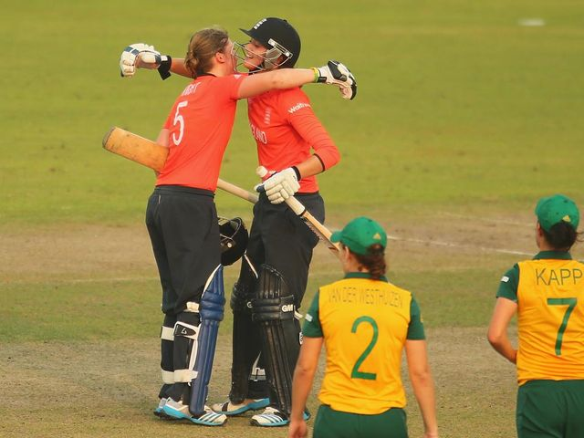 Heather Knight and Sarah Taylor celebrate England's success