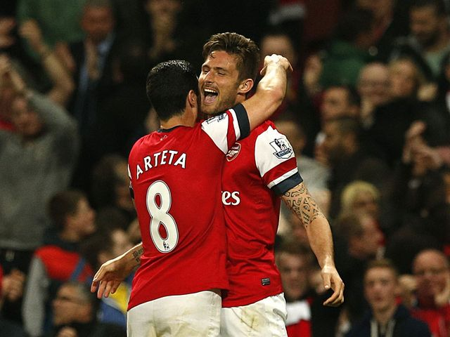 Arteta and Giroud celebrate on Monday