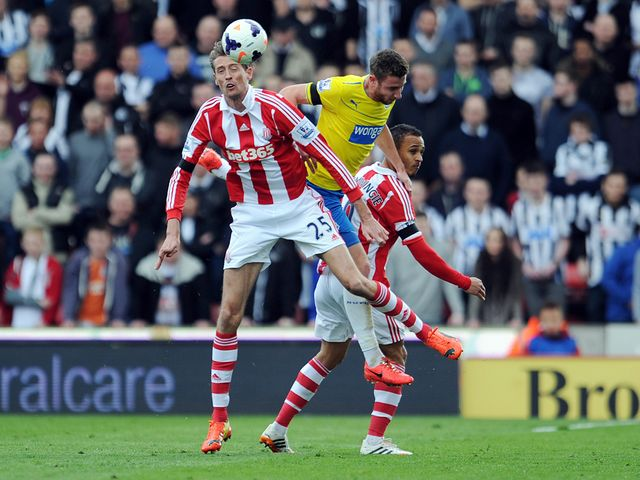 Crouch beats Dummett to a header