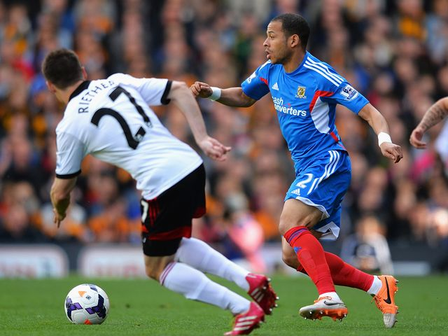 Liam Rosenior of Hull City takes on the Fulham defence