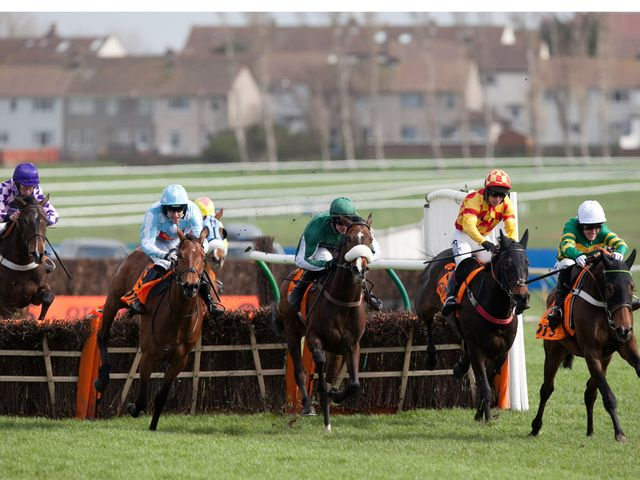 Cockney Sparrow (left) is about to swoop to win the Scottish Champion Hurdle