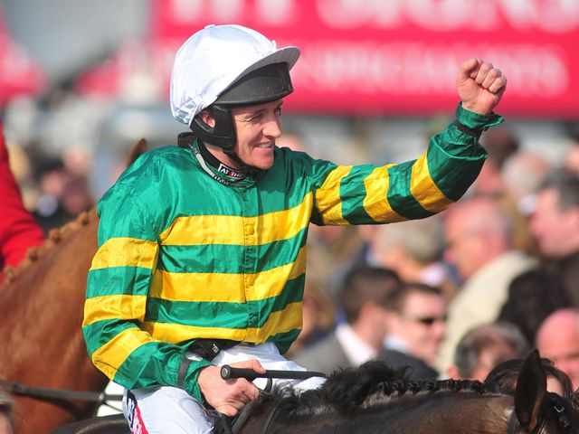 Jockey Barry Geraghty celebrates after riding Shutthefrontdoor to victory
