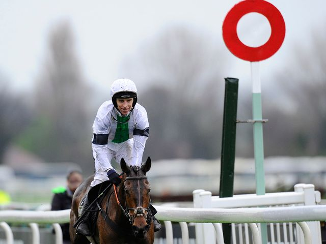 Leighton Aspell breaks out into a smile as Pineau De Re wins the Grand National