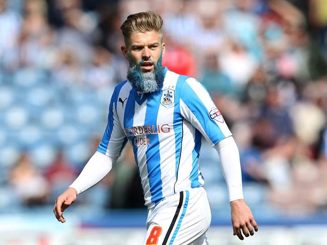 Huddersfield Town's Adam Clayton with a blue and white beard during their clash with Leicester