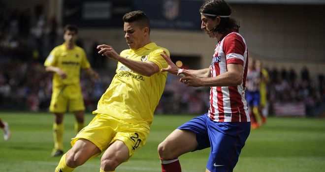 Gabriel Paulista and Filipe Luis compete for the ball