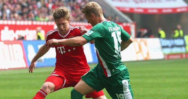Mitchell Weiser battles for the ball with Matthias Ostrzolek