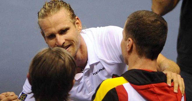 Peter Gojowczyk celebrates with his Germany team-mates