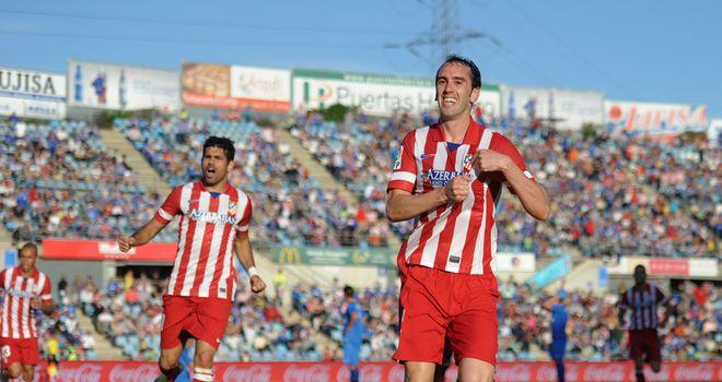 Diego Godin celebrates his goal