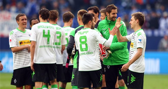 Gladbach players celebrate the narrow victory