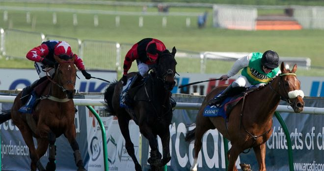 Al Co beatsTrustan Times and Godsmejudge to win the Coral Scottish Grand National