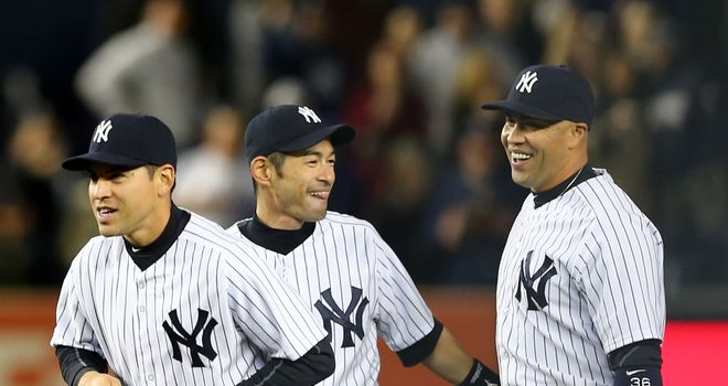 Jacoby Ellsbury,Ichiro Suzuki and Carlos Beltran of the New York Yankees celebrate