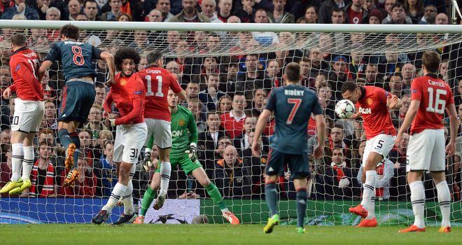 Manchester United defender Rio Ferdinand heads the ball away