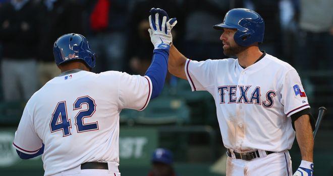 Prince Fielder (left): The Texas Ranger celebrates his homer with team-mate Kevin Kouzmanoff