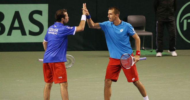 Radek Stepanek and Lukas Rosol celebrate clinching victory for the Czech Republic
